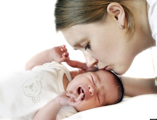 Mum kissing crying baby; Shutterstock ID 62713735; PO: The Huffington Post; Job: The Huffington Post; Client: The Huffington Post; Other: The Huffington Post